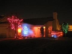 House lit up for Halloween with fogger, moving light, 4-channel effect lights, and specials.