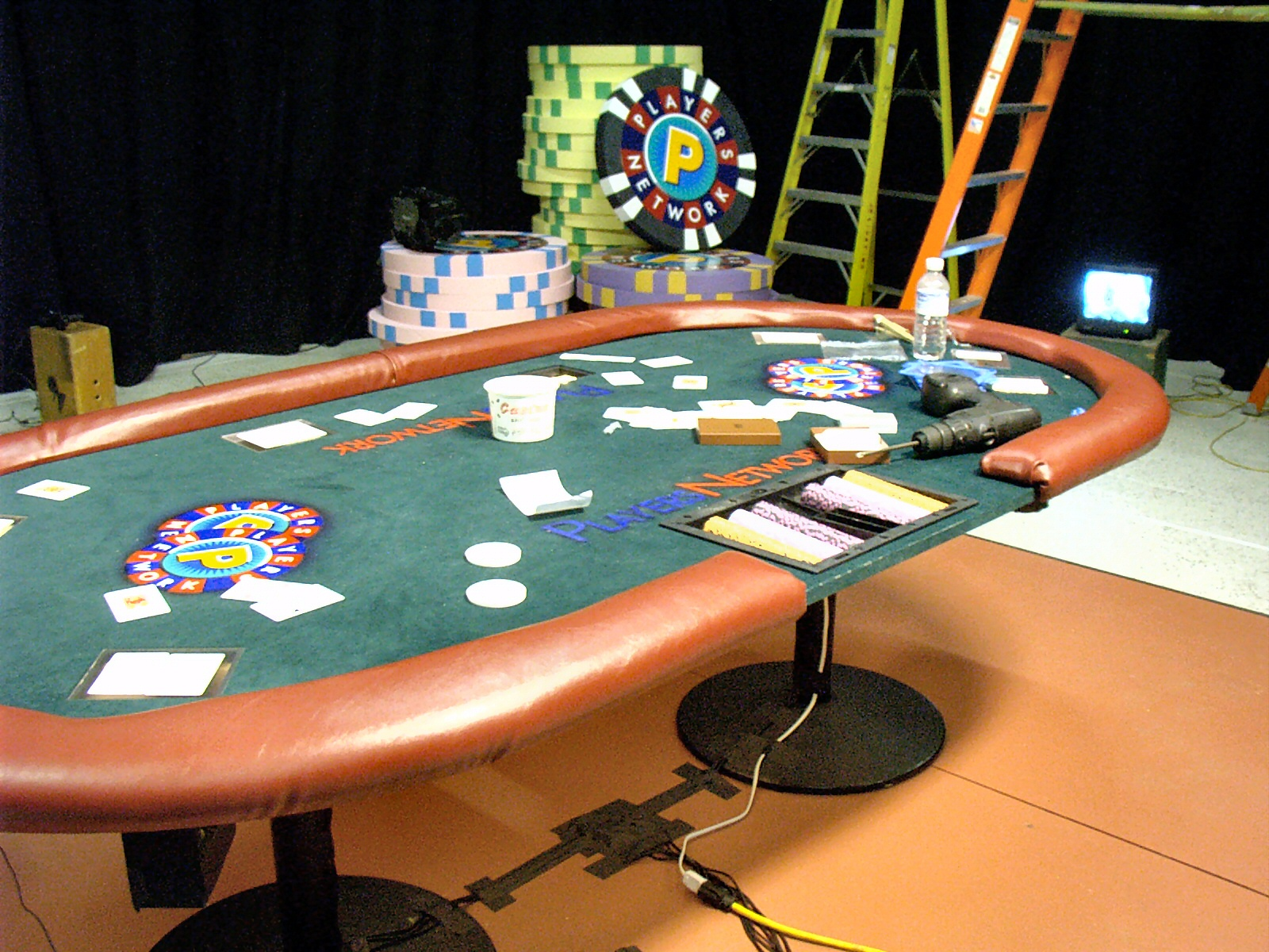 The shows poker table during stage construction note the bundle of video and power